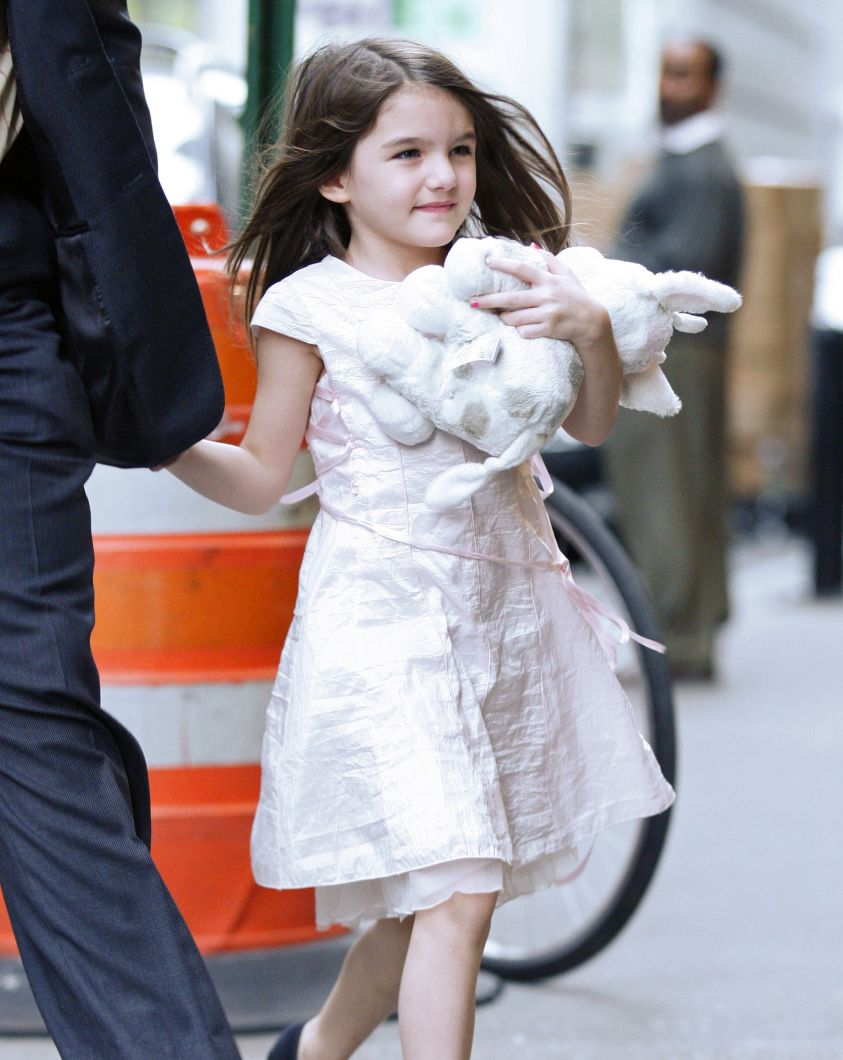 Suri Cruise shows off her party dress in NYC