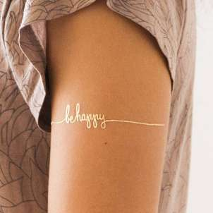 Be Happy, golden tattoo