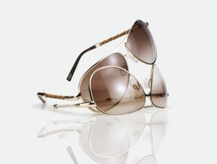 Tod's: i sunglasses chic con astine in pelle