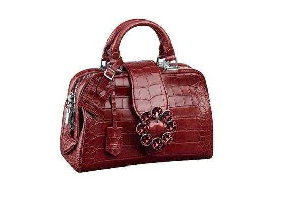 Handbag in rettile bordeaux